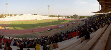 Shot from above a crowd watching a football game into the stadium of Bamako in Mali.