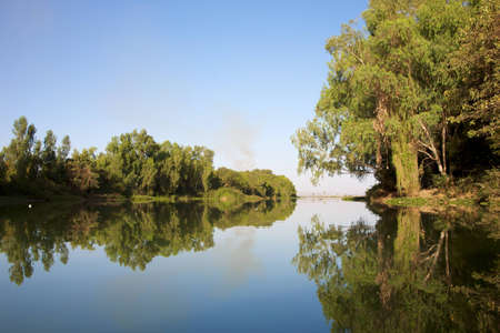 bamako: Landscape in Bamako, reflections of tress and water in vibrant colors.