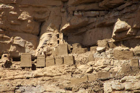 ethnology: The first Dogon people used to live in these small houses build directly in the cliff. Editorial