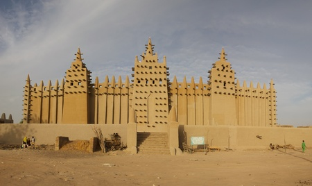 The big mosque in DjenneÌ and the traditional mud building in Mali.