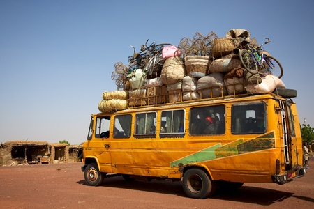 Over loaded mini van on a road in Mali Editorial