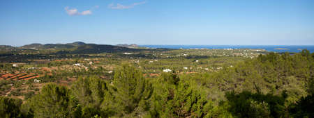 Panoramic landscape of the countryside and the sea in Ibiza photo