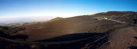 Panoramic view of the Etna early in the morning with a blue sky photo