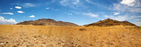parch: Surreal panorama of the Namib desert going towards solitaire and sossusvlei