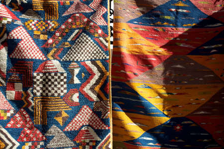 Berber culture - carpets and clothes found in morocco photo