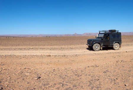 four wheel: A four wheel drive car on a desert road in Morocco