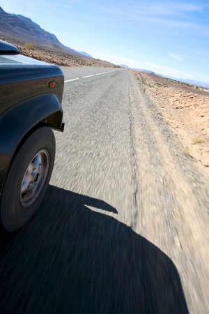 four wheel: A four wheel drive car on a road in Morocco