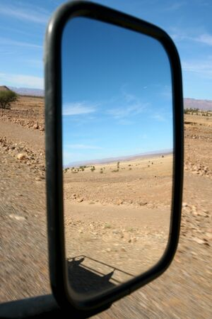 car mirror looking at the desert of Morocco close to merzouga Stock Photo - 12579049