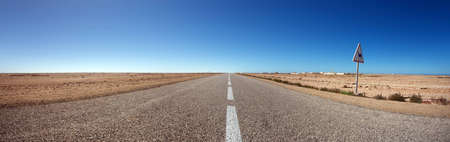 Straight road with nice blue sky in the south of Morocco photo