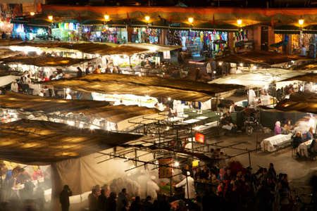 Square  Djamaa El Fna in Marrakesh at night with all the food shops Stock Photo - 12572178
