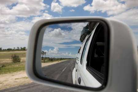 Mirror and african view while driving in Nambia - Kaokoland Stock Photo - 12647610