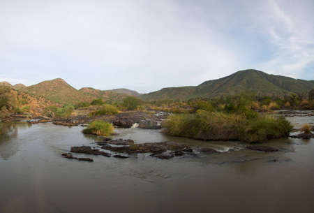 The Epupa Falls lie on the Kunene River, on the border of Angola and Namibia Stock Photo