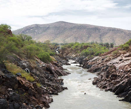 The Epupa Falls lie on the Kunene River, on the border of Angola and Namibia photo