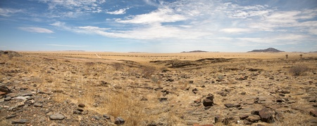 Surreal panorama of the Namib desert going towards Solitaire and Sossusvlei, Namibia.