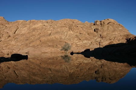 Wonderful lake in the desert of Sinai with sunrise with blue water and reflections photo