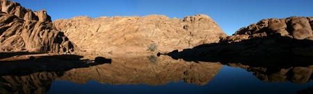 ten empty: Wonderful lake in the desert of Sinai with sunrise with blue water and reflections