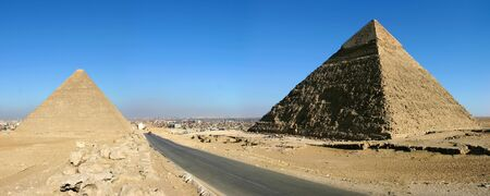 Panorama view of Giza pyramids with a blue sky photo