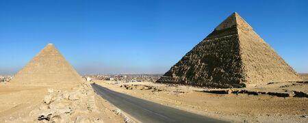panoramics: Panorama view of Giza pyramids with a blue sky