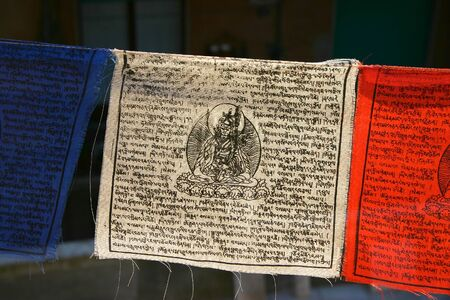 Close up of Buddhist prayer flags hanging on a rope Stock Photo - 12790180