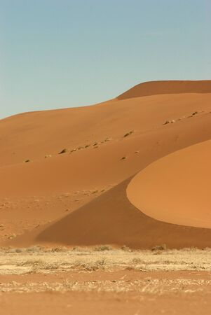 Incredible huge dunes of sand located in Sossusvlei in Namibia within the Namid desert photo