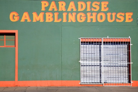 luderitz: Green House with yellow letters. Detail of architecture in the city of Luderitz, Namibia Editorial