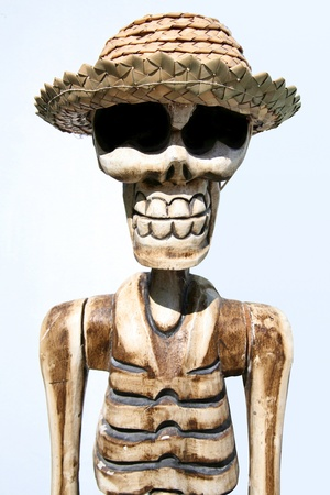 Skeleton wearing a funny hat on white background in the Maldives