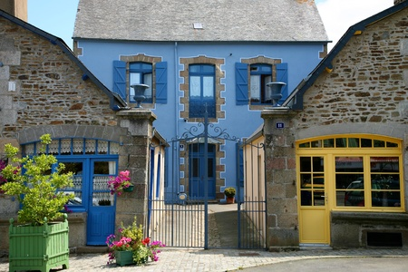 Facade of traditional breton houses with blue shutters, france Editorial