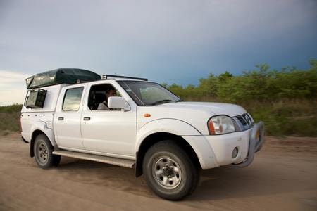 kalahari desert: White 4x4 offroad in the kalahari desert Stock Photo
