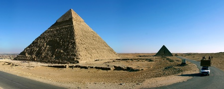 Panorama view of Giza pyramids with a clear blue sky, Egypt. photo