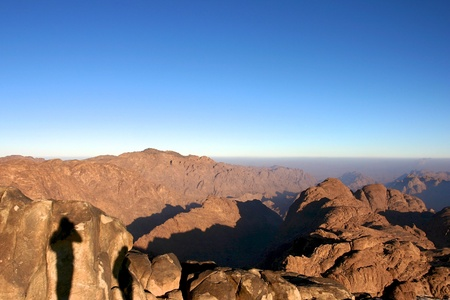 Two shadows in the Mont Sinai in Egypt early in the morning with sunrise photo