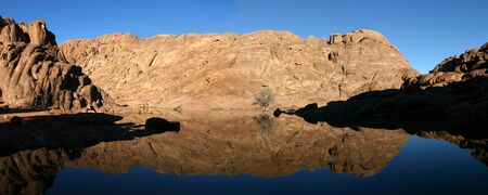 ten empty: Wonderful lake in the desert of Sinai with sunrise with blue water and reflections, Egypt. Stock Photo
