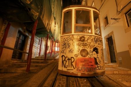 bairro: The Bica Elevator goes up the street in Lisbon Bairro Alto, Lisbon, Portugal
