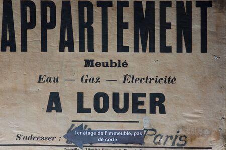 Vintage eal estate sign for rent apartment in Paris, France photo
