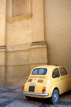Vintage Italian Car in Sicily with detail of an old church.