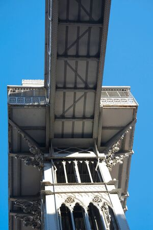 Santa Justa Elevator in Lisbon, Portugal against a blue sky from below point of view photo