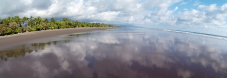 Panoramic view at the beach of Matapalo, Costa Rica. Matapalo is located in the Southern Pacific Coast. The main attractions are surfing and eco-tourism., Matapalo photo