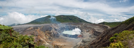 sulphur: Panoramic view of  fumarole smoke over the Poas Volcano in Costa Rica in 2012. Detail of the acid water crater with turquoise colors. Stock Photo