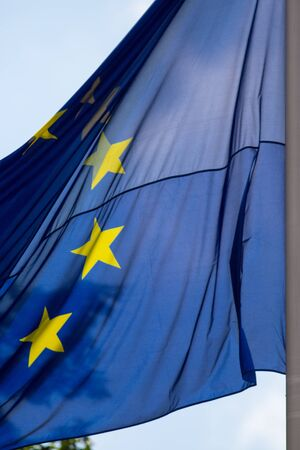 European EU flag waves in bright sun against a blue sky photo