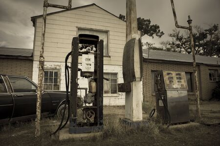 Old retro gas pumps in the rural landscape in Utah