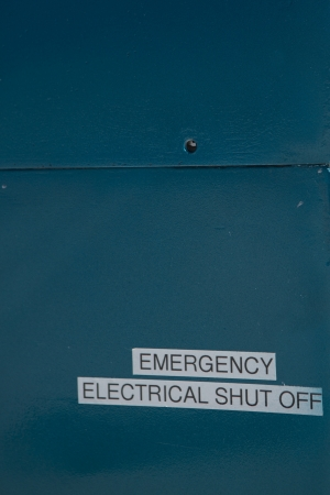 High voltage danger sign on side of electrical equipment photo