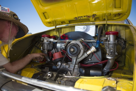 ut: SALT LAKE, UT - SEPTEMBER 8: An unidentified man showing the engine parts of his speed yellow car during the World of Speed at Bonneville Salt Flats Recreation Area Utah USA.