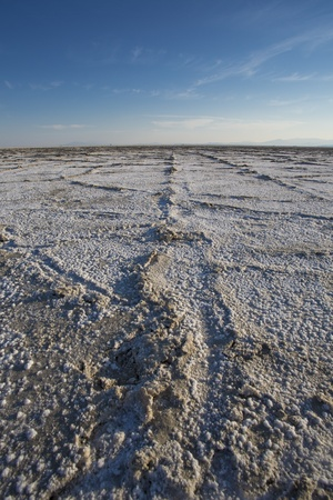 World famous Bonneville Salt Flats outside Salt Lake City Utah with mountains and blue skies. Detail of the salt on the ground Stock Photo - 17524595