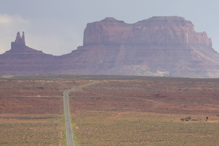 Empty road leading to Monument Valley with clear weather photo