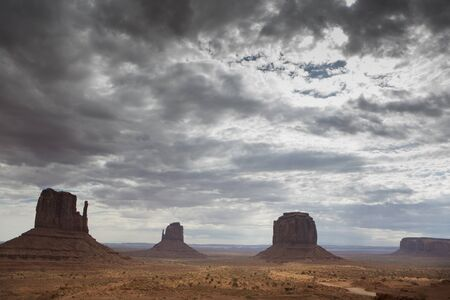 monument valley view: View of monument valley early in the morning with clouds Stock Photo