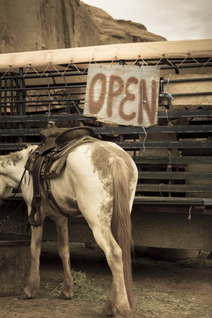 humor: Horse and an Open Sign in Monument Valley, Utah. Photo in Old style Stock Photo
