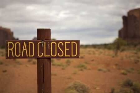 irony: Road Closed Sign in Monument Valley, Utah with no road in sight