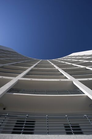 Modern Glass Architecture in Miami with a blue sky photo