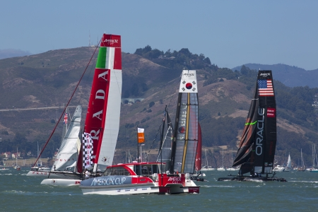 SAN FRANCISCO, CA - AUGUST 26: American team and the Corean team try to overtake the Italian team in the bay of San Francisco during the final of the America's Cup 2012.