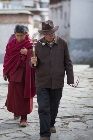 CHINA, TIBET, APRIL 18: Two monks walking and praying in Palkhor Monastery in Tibet, 18 April 2013.