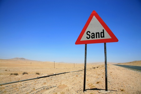 Danger road sign on the way to Luderitz, Namibia photo